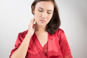 Woman touching skin tags